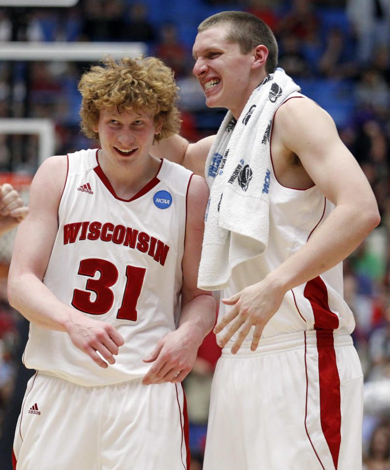 Wisconsin's Mike Bruesewitz, left, celebrates a three-point basket with Jared Berggren against Kansas State during a Southeast Regional NCAA college basketball tournament third round game Tucson, Ariz., Saturday, March 19, 2011. Wisconsin won 70-65. (AP Photo/Chris Carlson)