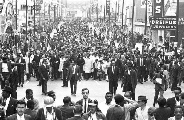 <p>Coretta Scott King (center left, in black) and Rev. Ralph Abernathy (center right), lead a massive march in Memphis. (Photo: Robert Abbott Sengstacke/Getty Images) </p>