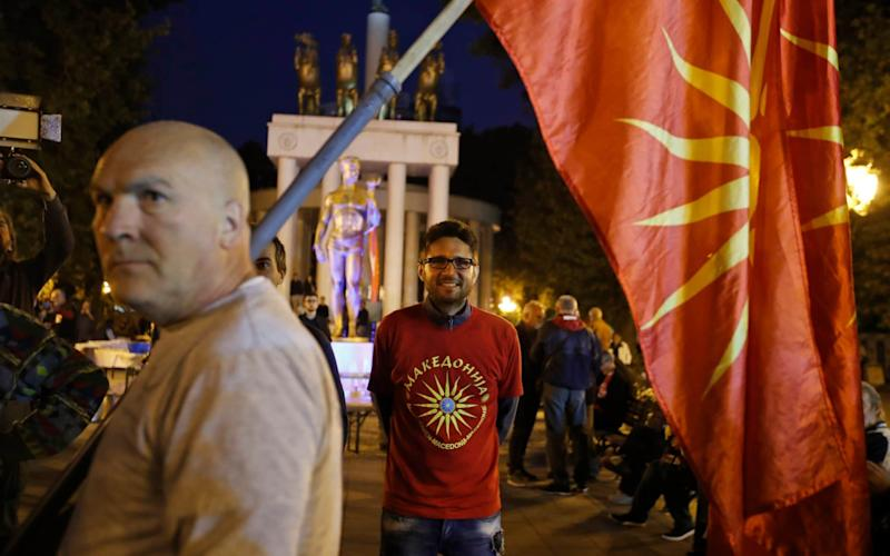 Supporters of a boycott of the referendum outside parliament in Skopje, Macedonia's capital, after turnout was reported to be just 29% - AP
