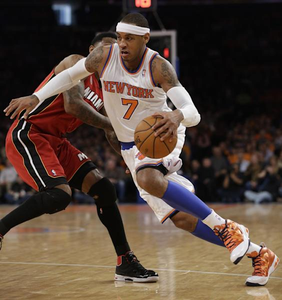 New York Knicks forward Carmelo Anthony (7) drives against Miami Heat forward Udonis Haslem (40) during the first half of their NBA basketball game at Madison Square Garden in New York, Sunday, March 3, 2013. (AP Photo/Kathy Willens)