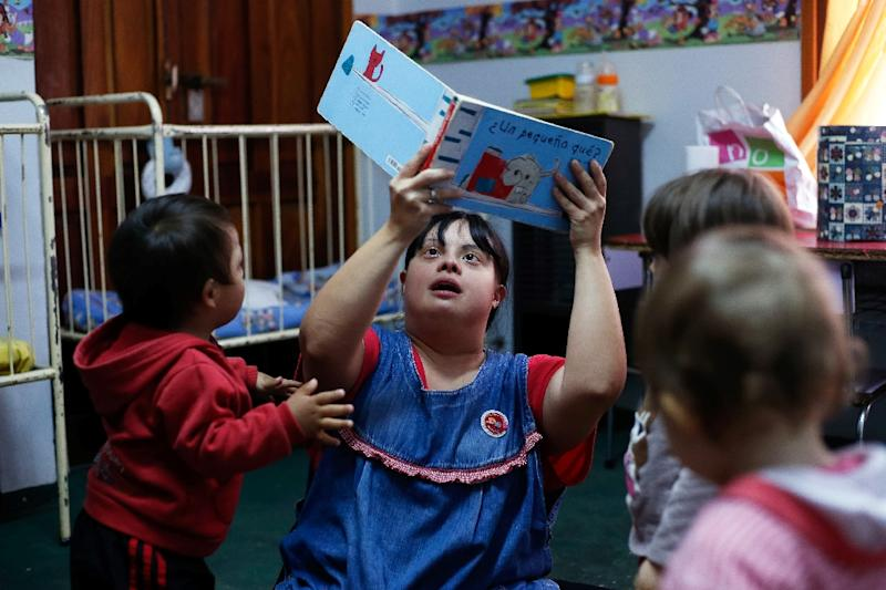 While there is some debate in Argentina about allowing people with Down syndrome into schools, Noelia Garella has been accepted by both staff and pupils at the Jermonito nursery (AFP Photo/Diego Lima)