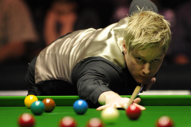 Neil Robertson of Australia plays a shot against Judd Trump of England during the semi-final match in the BGC Masters snooker tournament at Alexandra Palace in north London on sJanuary 21, 2012. Robertson went on to win the match 6-3. AFP PHOTO / CARL COURT (Photo credit should read CARL COURT/AFP/Getty Images)