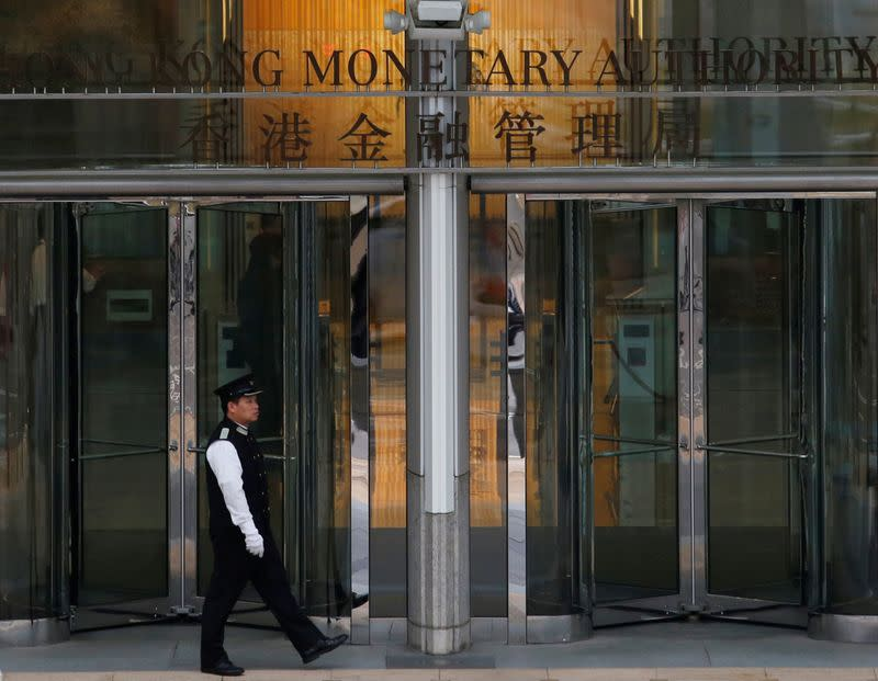 Hong Kong central bank cuts rates, bank capital buffer requirements