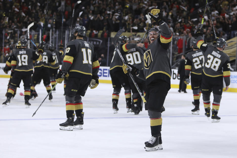 Vegas Golden Knights center Jonathan Marchessault (81) celebrates after the Golden Knights defeated the Minnesota Wild 6-2 in Game 7 of an NHL hockey Stanley Cup first-round playoff series Friday, May 28, 2021, in Las Vegas. (AP Photo/Joe Buglewicz)