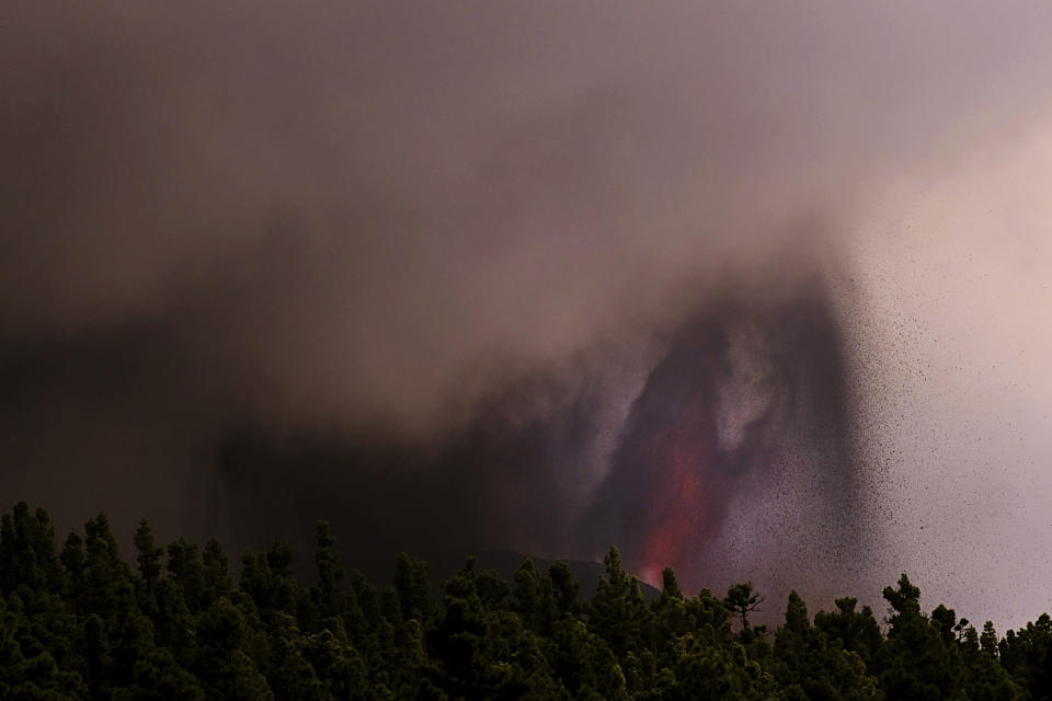Lava flows from a volcano on the Canary island of La Palma, Spain on Sunday Sept. 26, 2021. A massive cloud of ash prevented flights in and out of the Spanish island of La Palma on Sunday as molten rock continued to be flung high into the air from an erupting volcano. (AP Photo/Daniel Roca)