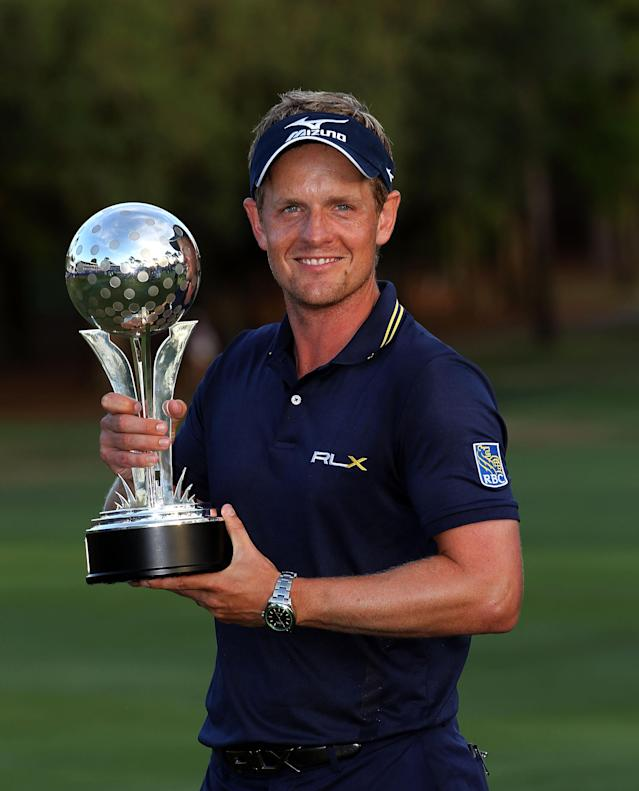 PALM HARBOR, FL - MARCH 18: Luke Donald of England holds the trophy after winning the Transitions Championship at the Innisbrook Resort and Golf Club on March 18, 2012 in Palm Harbor, Florida. (Photo by Sam Greenwood/Getty Images)