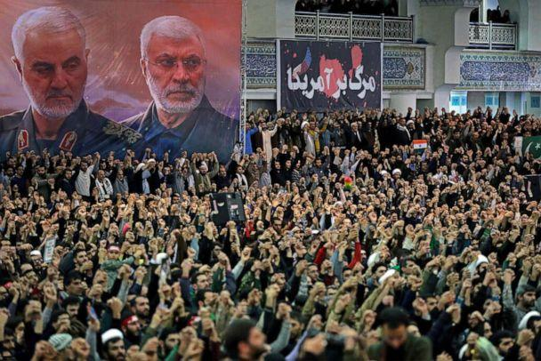 Posters show Iranian military commander Qassem Soleimani and the Iraqi militia commander Abu Mahdi al-Muhandis, both dead, as worshipers chant during a Friday prayers sermon led by Iran's Supreme Leader Ayatollah Ali Khamenei, in Tehran, Jan. 17, 2020. (Official Khamenei Website Handout Via Reuters)