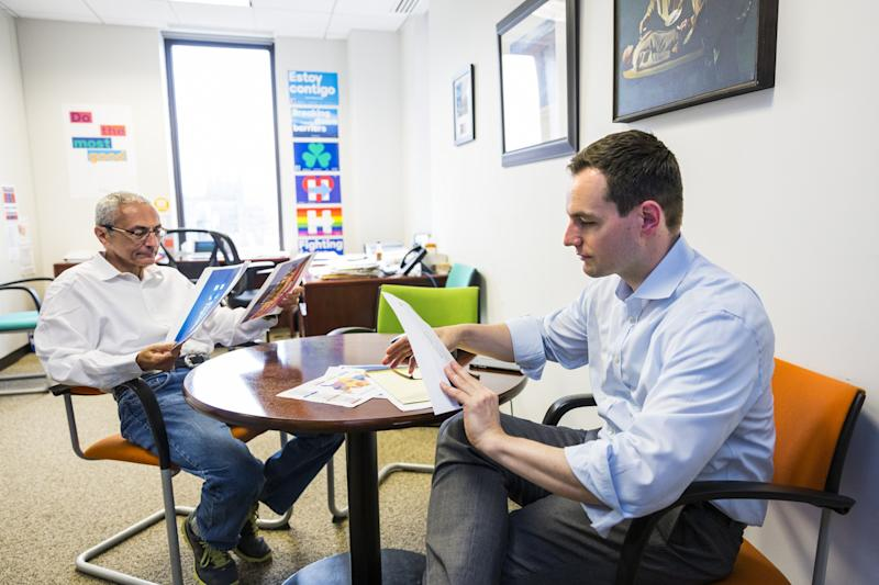 John Podesta, campaign chairman, left, and Robby Mook, campaign manager for Democratic presidential candidate Hillary Clinton, meet at campaign headquarters in Brooklyn, N.Y. (Photo: Brooks Kraft/Getty Images)