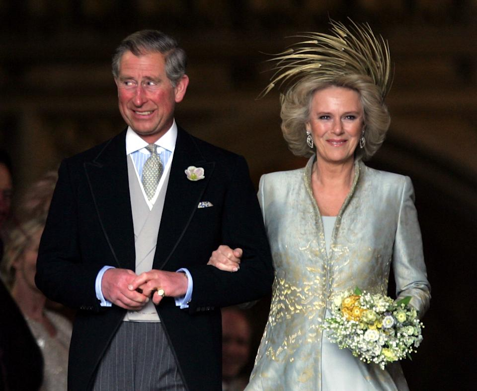 Britain's Prince Charles grins next to the Duchess of Cornwall as they leave St. George's Chapel in Windsor Castle, southern England, after the Service of Prayer and Dedication following their marriage, April 9, 2005. Prince Charles and his long-term partner Camilla Parker Bowles, who became Her Royal Highness the Duchess of Cornwall on their marriage, married on Saturday in a low-key ceremony. Pictures of the Month April 2005 REUTERS/Toby Melville PICTURES OF THE YEAR 2005  TM/CRB/SM