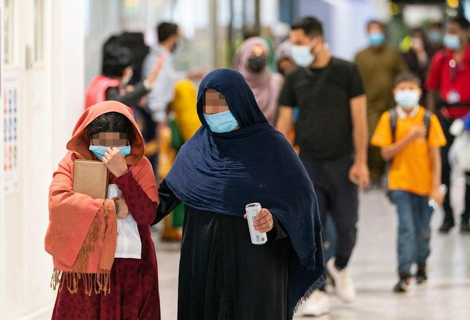 Refugees from Afghanistan arrive on a evacuation flight at Heathrow Airport, London. (Dominic Lipinski/PA) (PA Wire)