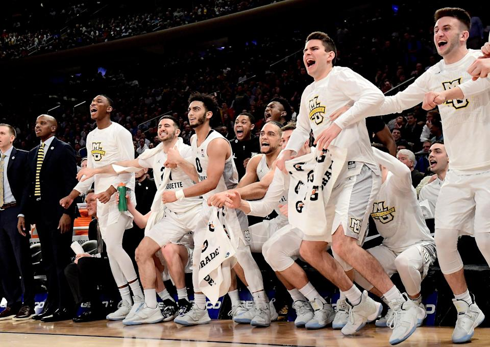 NEW YORK, NEW YORK - MARCH 14:  Markus Howard #0 of the Marquette Golden Eagles celebrates a basket with his teammates on the bench after a basket against the St. John's Red Storm during the Quarterfinals of the 2019 Big East men's basketball tournament at Madison Square Garden on March 14, 2019 in New York City. (Photo by Steven Ryan/Getty Images)