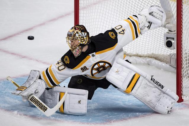 Boston Bruins goalie Tuukka Rask deflects a shot as they face the Montreal Canadiens during the first period in Game 4 in the second round of the NHL Stanley Cup playoffs Thursday, May 8, 2014, in Montreal. (AP Photo/The Canadian Press, Paul Chiasson)