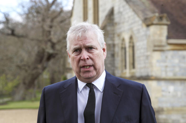 Britain's Prince Andrew during a television interview at the Royal Chapel of All Saints at Royal Lodge, Windsor, following the announcement of Prince Philip, in England, Sunday, April 11, 2021. Britain's Prince Philip, the irascible and tough-minded husband of Queen Elizabeth II who spent more than seven decades supporting his wife in a role that mostly defined his life, died on Friday. (Steve Parsons/Pool Photo via AP)