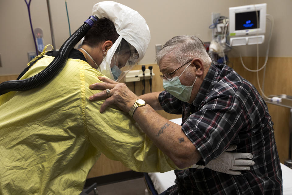 A healthcare worker helps Covid patient at a medical centre in North Dakota which has become awash with the virus. Source: Getty