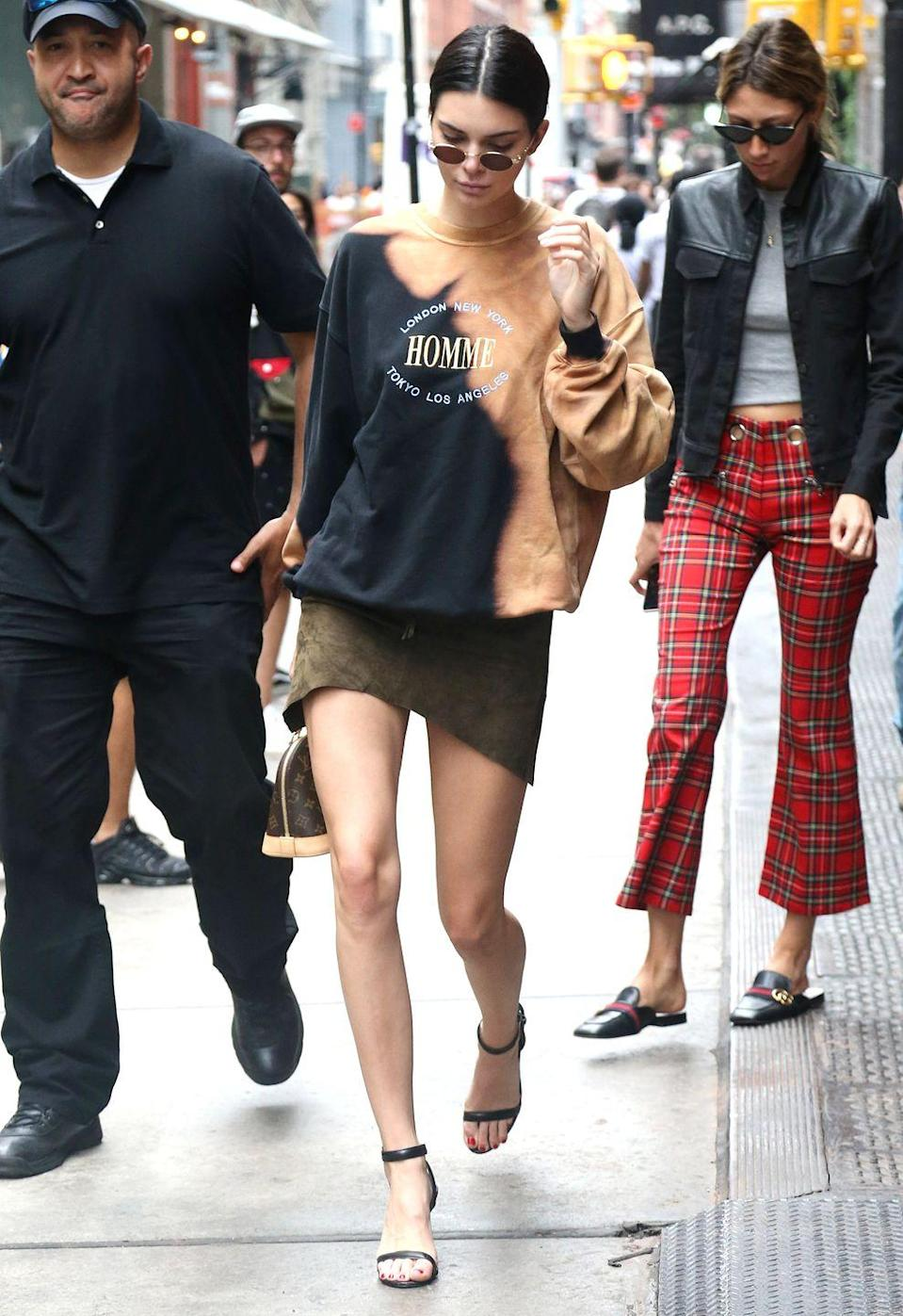 <p>Kendall sports a 'Homme' Balenciaga sweatshirt whilst out and about in New York, July 2017</p>
