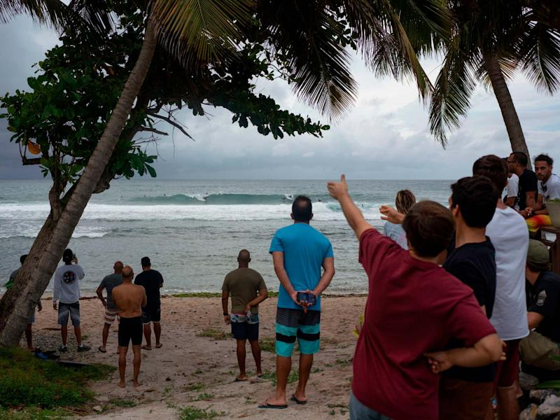 People gather on the Puerto Rico coast hours before the storm hits: AFP/Getty Images