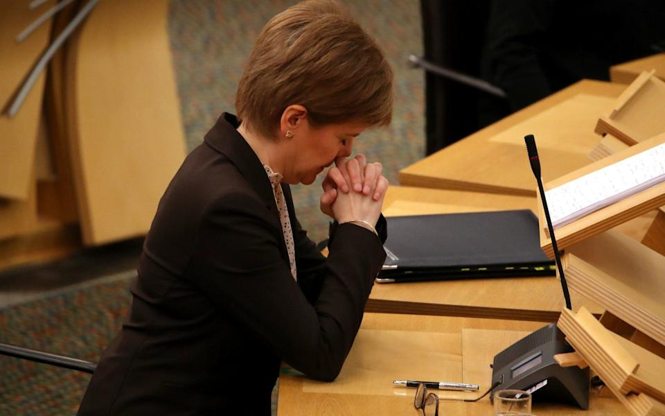 First Minister Nicola Sturgeon reacts as she delivers a statement at Holyrood, Edinburgh, announcing that Scotland will be placed in lockdown from midnight for the duration of January - Andrew Milligan/PA Wire