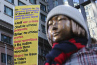 A statue symbolizing a wartime sex slave is displayed near the Japanese Embassy in Seoul, South Korea, Friday, Jan. 8, 2021. A South Korean court on Friday ordered Japan to financially compensate 12 South Korean women forced to work as sex slaves for Japanese troops during World War II, the first such ruling expected to rekindle animosities between the Asian neighbors. (AP Photo/Ahn Young-joon)