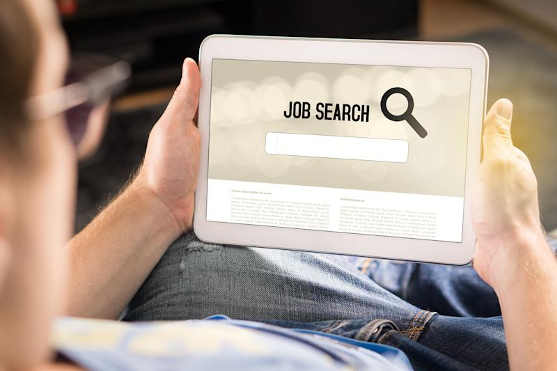 Man holding tablet with job search app on screen