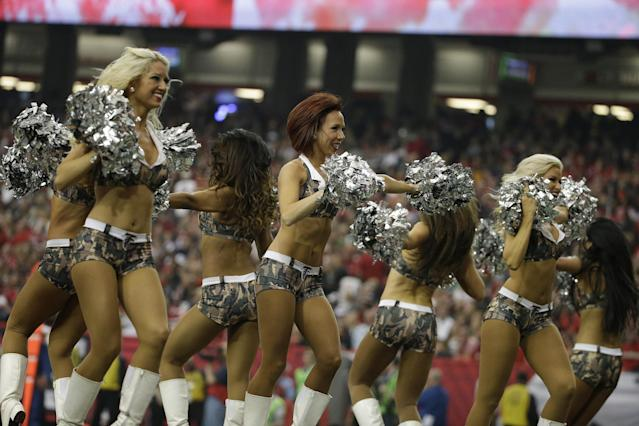 Atlanta Falcons cheerleaders wearing Digital Camouflage uniforms in Salute to Service perform during the first half of an NFL football game against the Seattle Seahawks, Sunday, Nov. 10, 2013, in Atlanta. (AP Photo/David Goldman)