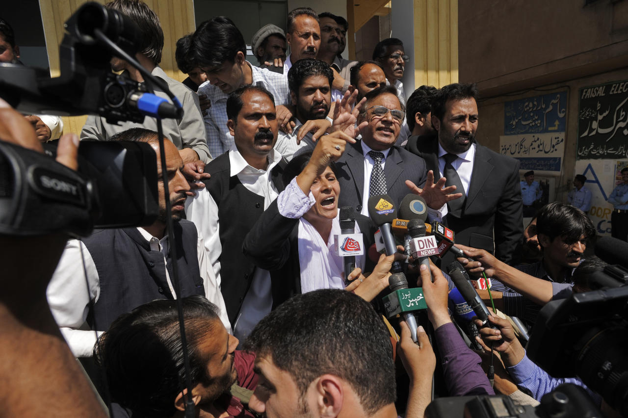 Supporters of Pakistan's former President and military ruler Pervez Musharraf chant slogans against the court decision at the High Court in Islamabad, Pakistan, Thursday, April 18, 2013. Musharraf and his security team pushed past policemen and sped away from a court in the country's capital on Thursday after his bail was revoked in a case in which he is accused of treason. (AP Photo/B.K. Bangash)
