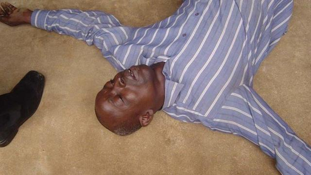 Nigerian man lies on ground during healing session in Lagos in undated picture.
