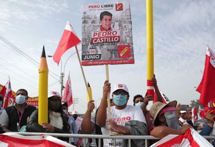 A supporter holds a sign in support of Peru's socialist presidential candidate Castillo in Lima