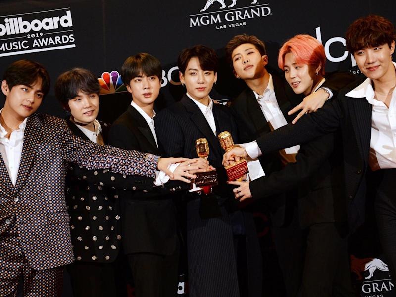 BTS pose in the press room with their awards during the 2019 Billboard Music Awards at the MGM Grand Garden Arena on 1 May, 2019, in Las Vegas, Nevada: BRIDGET BENNETT/AFP/Getty Images