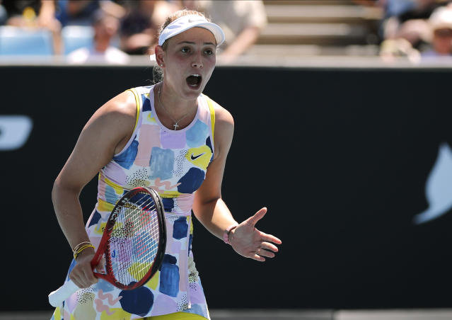 Croatia's Donna Vekic reacts after losing point to Poland's Iga Swiatek during their third round singles match at the Australian Open tennis championship in Melbourne, Australia, Saturday, Jan. 25, 2020. (AP Photo/Andy Wong)