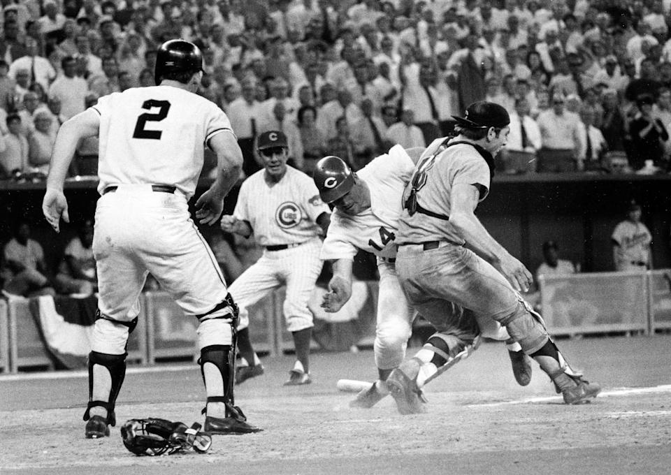 Pete Rose slams into catcher Ray Fosse to score in the 12th inning of the 1970 All-Star Game in Cincinnati.