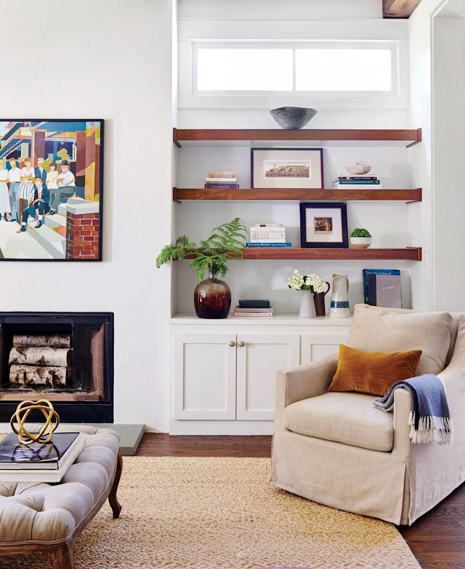 """<p>Designer Anna Braund coated almost every wall in her 2,500-square-foot cottage in <a href=""""https://www.benjaminmoore.com/en-us/color-overview/find-your-color/color/oc-45/swiss-coffee?color=OC-45"""" rel=""""nofollow noopener"""" target=""""_blank"""" data-ylk=""""slk:Benjamin Moore's Swiss Coffee"""" class=""""link rapid-noclick-resp"""">Benjamin Moore's Swiss Coffee</a>. See more <a href=""""https://www.southernliving.com/home/decor/2500-square-foot-white-cottage"""" rel=""""nofollow noopener"""" target=""""_blank"""" data-ylk=""""slk:here."""" class=""""link rapid-noclick-resp"""">here.</a></p>"""