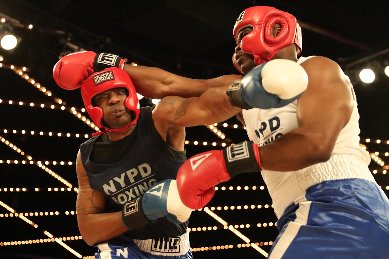<p>Larry Carson (red) fights Kevon Sample (blue) in the LT Rumble Match at the NYPD Boxing Championships at the Hulu Theater at Madison Square Garden on March 15, 2018. (Gordon Donovan/Yahoo News) </p>