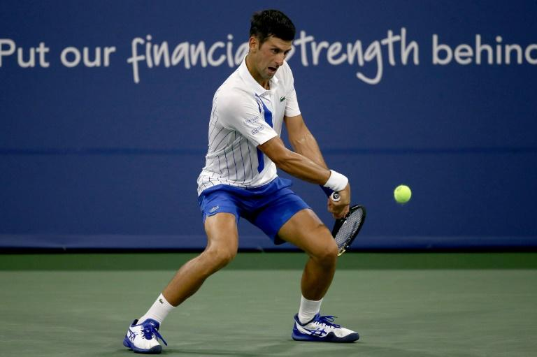 Flustered Williams crashes out, Djokovic reaches quarter-finals