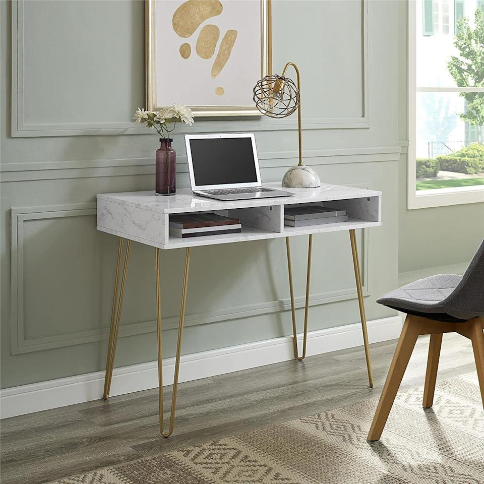 """Becausemaybe it's time you stop balancing your laptop on your lap on the couch. Just because it's *called* that doesn't mean that you have to park it there.<br /><br /><strong><a href=""""https://www.amazon.com/Novogratz-9618891COM-Computer-Storage-Marble/dp/B07FCTCSYW?&linkCode=ll1&tag=huffpost-bfsyndication-20&linkId=8ef255ae9515132f1ee19774f315b2bc&language=en_US&ref_=as_li_ss_tl"""" target=""""_blank"""" rel=""""noopener noreferrer"""">Get it from Novogratz on Amazon for $106.92 (available in two colors).</a></strong>"""