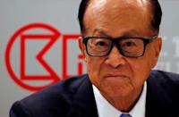 FILE PHOTO: Hong Kong tycoon Li Ka-shing looks on during a news conference announcing the CK Hutchison Holdings company results in Hong Kong