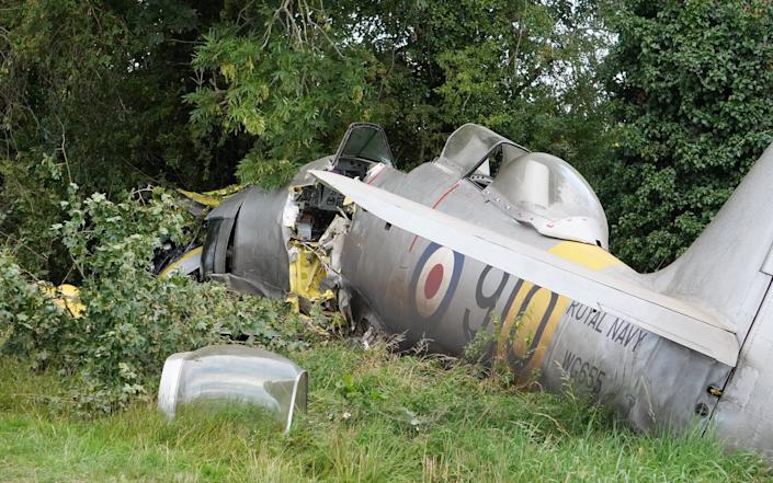 A very rare vintage fighter plane crashed last night with two people on board. - SWNS