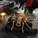 <p>Take your tabletop to the next level with this gold <span>Jeweled Spider</span> ($30).</p>
