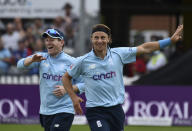 England's Tom Curran, right, and captain Eoin Morgan celebrate the dismissal of Sri Lanka's Chamika Karunaratna during the third one day international cricket match between England and Sri Lanka, at Bristol County Ground in Bristol, England, Sunday, July 4, 2021. (AP Photo/Rui Vieira)