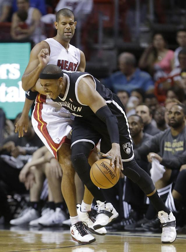 Brooklyn Nets forward Paul Pierce drives around Miami Heat forward Shane Battier during the first half of an NBA basketball game, Tuesday, April 8, 2014 in Miami. (AP Photo/Wilfredo Lee)