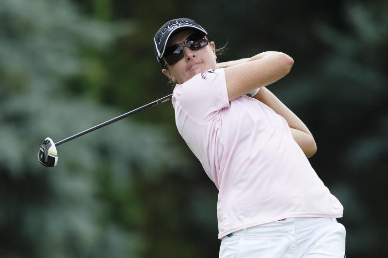 Alison Walshe tees off on the ninth hole during the first round of the Marathon Classic golf tournament at Highland Meadows Golf Club in Sylvania, Ohio, Thursday, July 18, 2013. (AP Photo/Rick Osentoski)