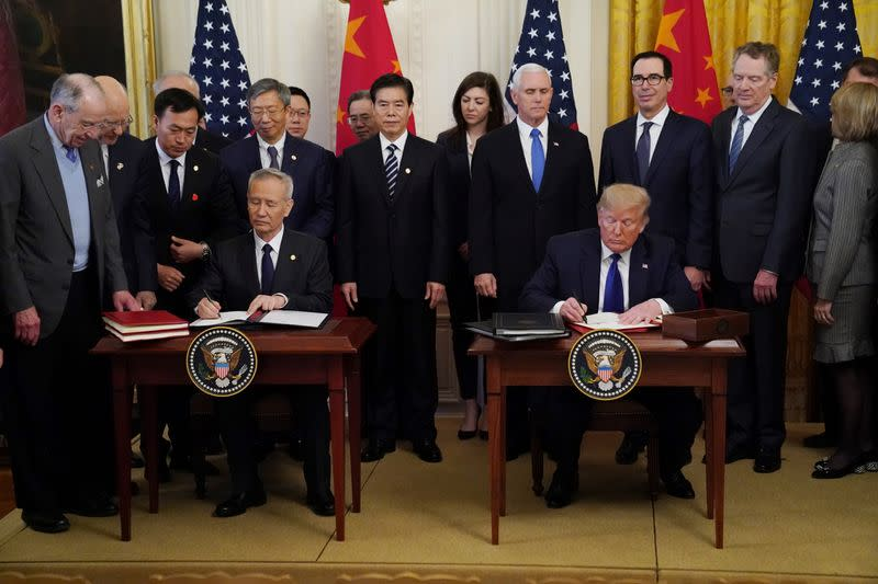 """Chinese Vice Premier Liu He and U.S. President Donald Trump sign """"phase one"""" of the U.S.-China trade agreement at the White House in Washington"""