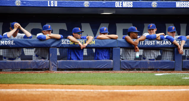 Florida players watch during the seventh inning of a Southeastern Conference tournament NCAA college baseball game against LSU as they are down 11-0. Play resumed in the sixth inning after an overnight fog delay, Saturday, May 26, 2018, in Hoover, Ala. (AP Photo/Butch Dill)