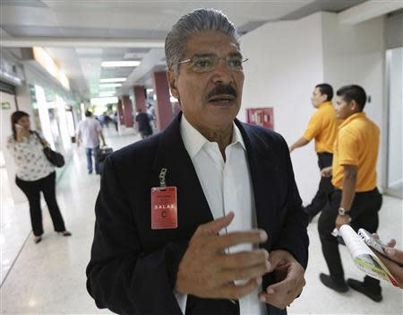 Quijano, presidential candidate of ARENA speaks to Reuters journalists at the international airport in San Salvador