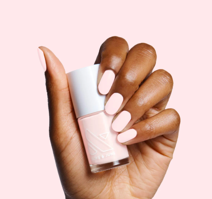 """<h2>Olive & June Pink Sands Nail Polish</h2><br>Out of all the vibrant, flirty, and fun <a href=""""https://refinery29.com/en-us/2021/05/10469470/summer-nail-polish-colors"""" rel=""""nofollow noopener"""" target=""""_blank"""" data-ylk=""""slk:nail polish colors for summer"""" class=""""link rapid-noclick-resp"""">nail polish colors for summer</a> 2021, Olive & June's Pink Sands took the cake. Described by the brand's founder, Sarah Gibson Tuttle, as a """"sun-bleached pink"""", R29's beauty team recommends it to those looking for """"a bright white polish that's a little softer with a hint of pink"""".<br><br><em>Shop <strong><a href=""""https://oliveandjune.com/products/pink-sands"""" rel=""""nofollow noopener"""" target=""""_blank"""" data-ylk=""""slk:Olive & June"""" class=""""link rapid-noclick-resp"""">Olive & June</a></strong></em><br><br><strong>Olive & June</strong> Pink Sands, $, available at <a href=""""https://go.skimresources.com/?id=30283X879131&url=https%3A%2F%2Foliveandjune.com%2Fproducts%2Fpink-sands"""" rel=""""nofollow noopener"""" target=""""_blank"""" data-ylk=""""slk:Olive & June"""" class=""""link rapid-noclick-resp"""">Olive & June</a>"""