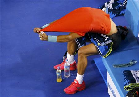Rafael Nadal of Spain removes his shirt during his men's singles semi-final match against Roger Federer of Switzerland at the Australian Open 2014 tennis tournament in Melbourne January 24, 2014. REUTERS/David Gray