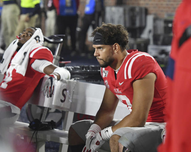 Mississippi quarterback Matt Corral sits on the bench during the final minutes of the team's NCAA college football game against Texas A&M in Oxford, Miss., Saturday, Oct. 19, 2019. Texas A&M won 24-17. (AP Photo/Thomas Graning)