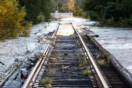 Debris swept downriver by the rising Tar River litter a flooded rail bridge crossing the river from Tarboro into Princeville as the river crests in the aftermath of Hurricane Matthew, in Tarboro, North Carolina on October 13, 2016. REUTERS/Jonathan Drake