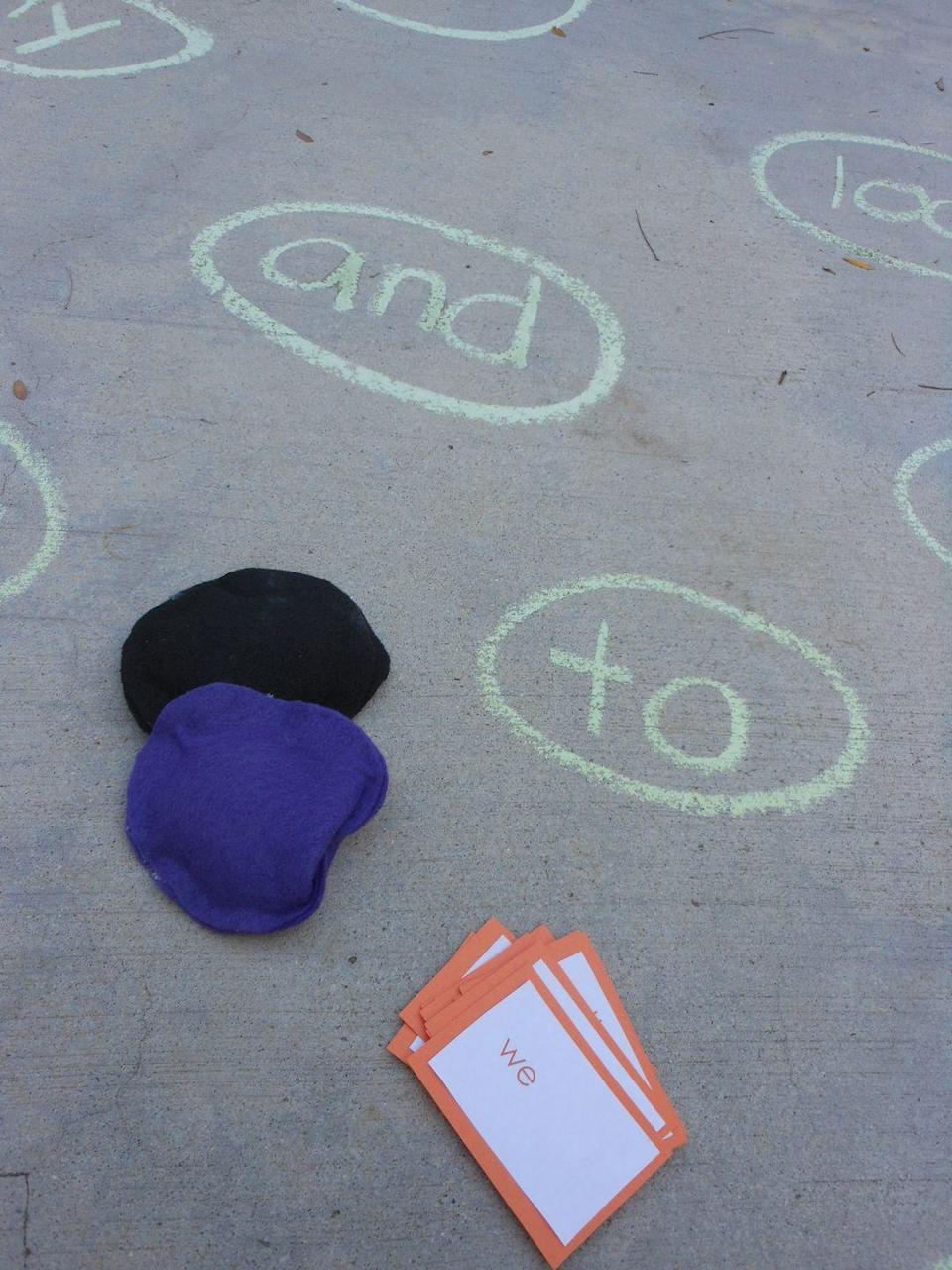 """<p>Use chalk play as a way for kids to practice their sight words: Simply write the words on the sidewalk, tossing a bean bag and practicing each word it lands on a few times.</p><p><em><a href=""""https://confidencemeetsparenting.com/sight-word-bean-bag-toss/"""" rel=""""nofollow noopener"""" target=""""_blank"""" data-ylk=""""slk:Get the tutorial from Confidence Meets Parenting »"""" class=""""link rapid-noclick-resp"""">Get the tutorial from Confidence Meets Parenting »</a></em></p>"""