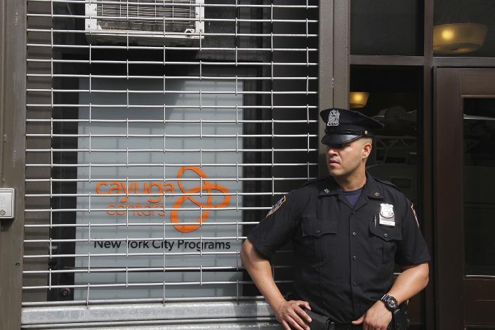 <p>NEW YORK, NY – JUNE 21: New York City police officers (NYPD) stand guard outside of Cayuga Center, a immigrant foster care facility, in East Harlem where immigrant children who have been separated from their parents are taken during the day as a result of President Donald Trump's Zero Tolerance illegal immigration policy in New York City on June 21, 2018. (Photo: Rainmaker Photo/MediaPunch/IPX/AP) </p>