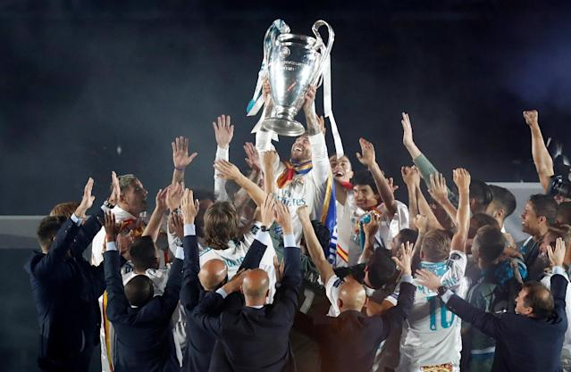 Soccer Football - Real Madrid celebrate winning the Champions League Final - Santiago Bernabeu, Madrid, Spain - May 27, 2018 Real Madrid's Sergio Ramos lifts the trophy during the victory celebrations REUTERS/Javier Barbancho